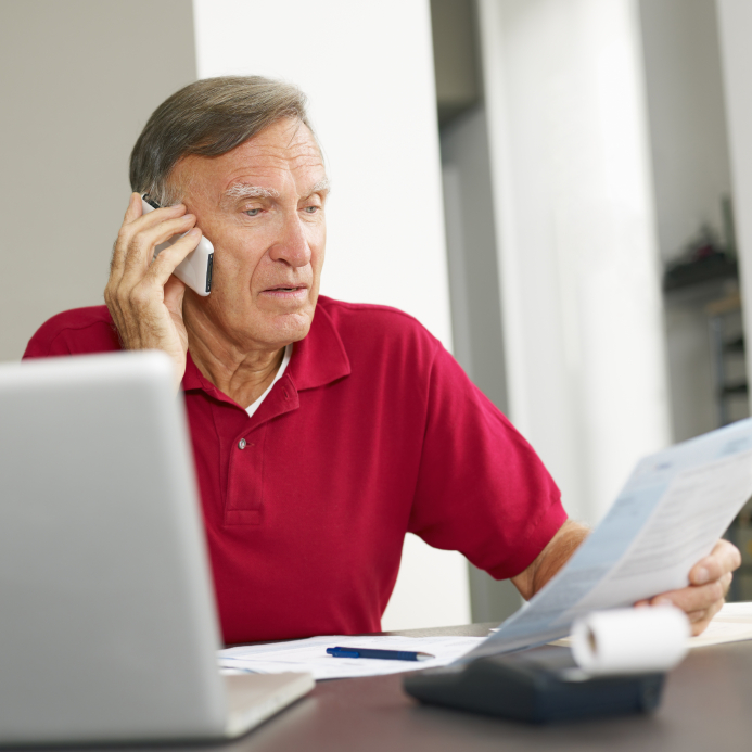 Senior man checking home finances